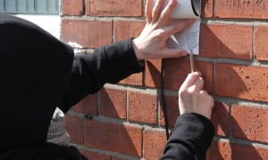 Collecting wall rubbings in Belfast